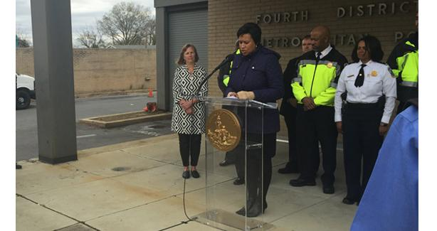 Photo from press conference in which several DFS units assist MPD with case closures